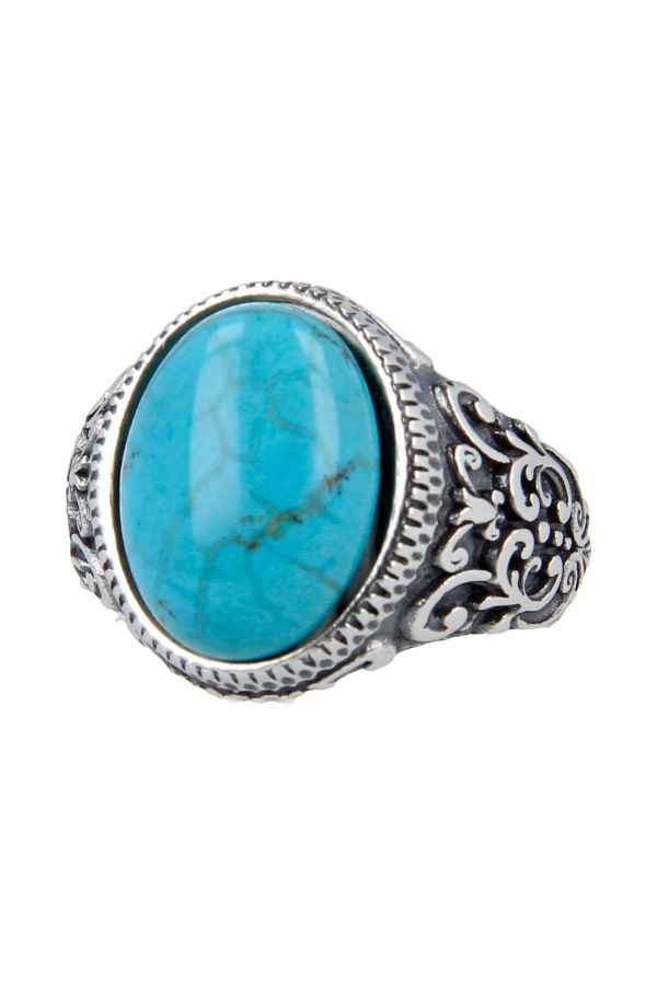 Silver ring inlaid with oval stone